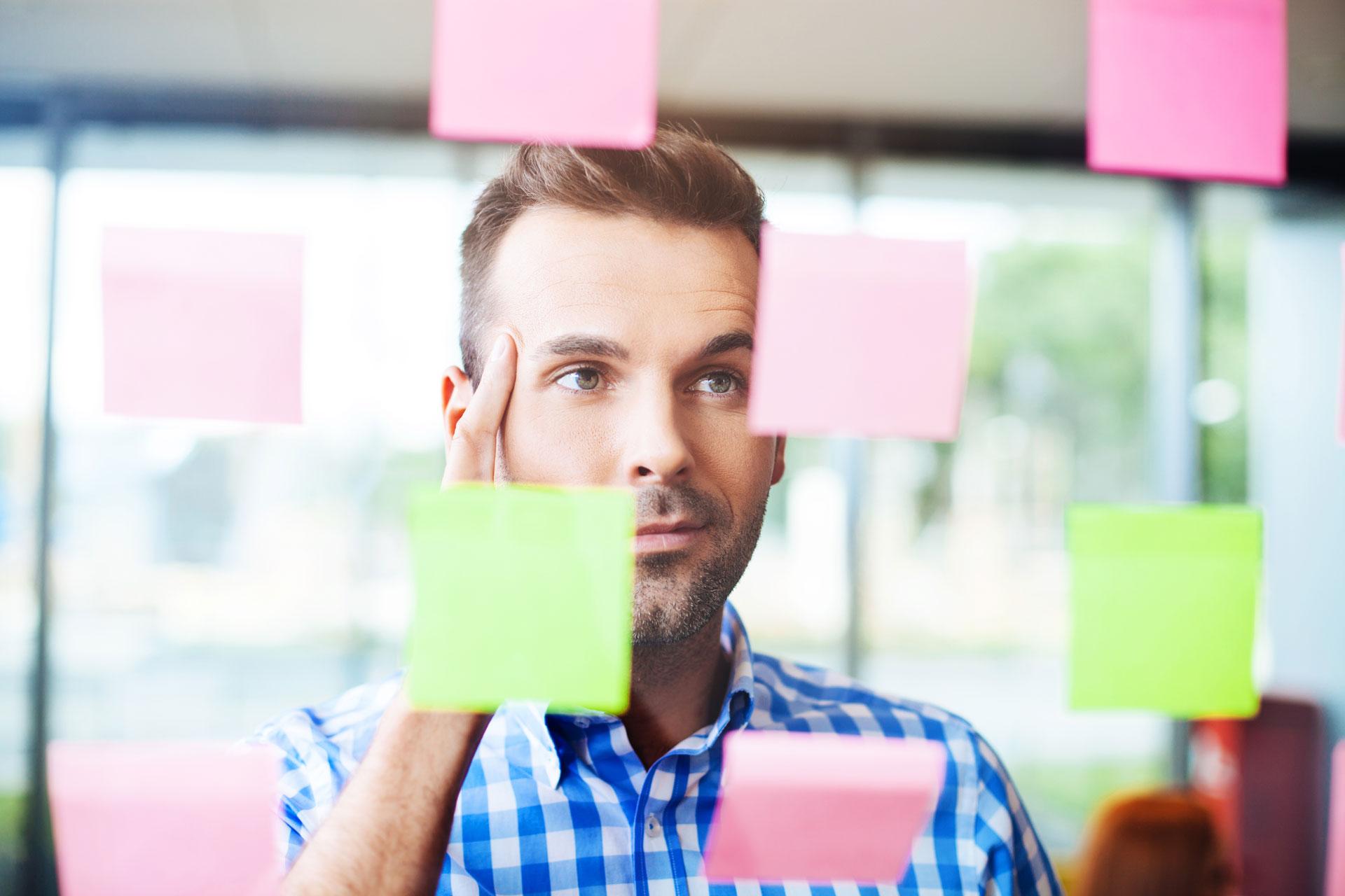man looking at notes